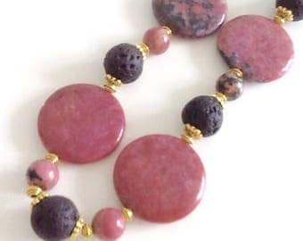 Rhodonite necklace, large pink and black round beads, black textured lava beads, gold tone spacers and clasp, very chic, one-off