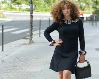 Robe noire vintage des années sixties chic et glamour