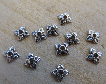 Set of 20 bead caps shaped 4 sheets of 6 x 6 mm antique silver color metal.