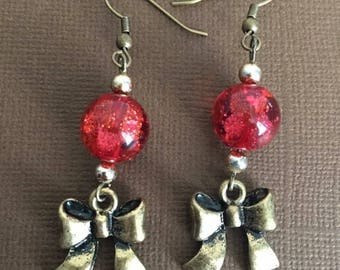 B bronze bow with glitter red bead earrings