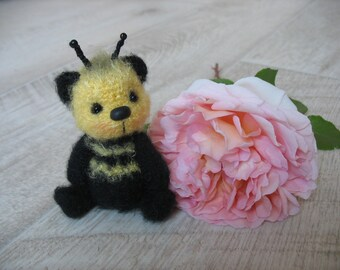 Miniature crocheted Bear Bee, knitting by a hook of a bear of Teddy, knitted toys