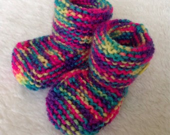 Soft hand knitted girls rainbow baby booties boots. Yellow button detail. 0-6 months.
