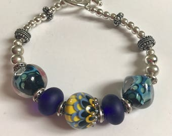 Blue and yellow lampwork bracelet