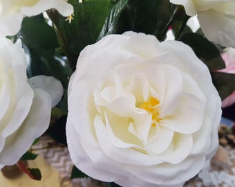 Open silk roses
