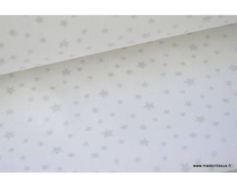 Printed cotton fabric design on white silver stars