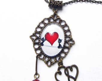 Pretty kitties and red heart pendant