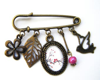 "Brooch ""bird on branch"", bronze costume jewelry"