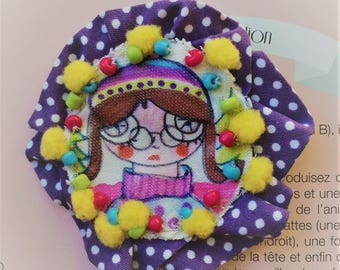 Textile brooch with fabric transfer image and glass beads