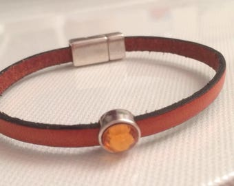 2 orange 5 mm leather bracelets