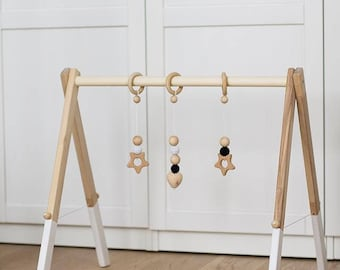 Wooden baby gym, no hangers, only frame + three wooden rings