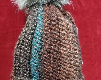 Handmade crochet hat with faux fur pom pom