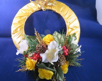 Christmas Wreath with silk flowers and ribbons, poinsettias,