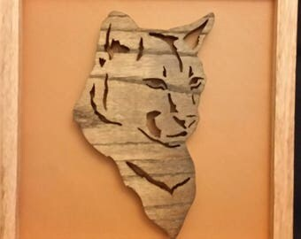 Leopard wood carving