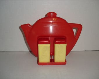 Vintage Red Plastic SUPERLON Teapot Holder with Salt and Pepper Shakers.