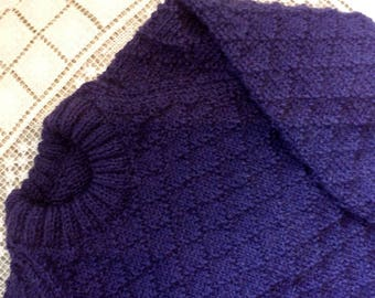 A Bright purple sweater in size two for boy or girl