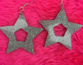 Big glittery star earrings silver