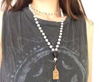 White bone double beaded necklace with brass buddha pendant