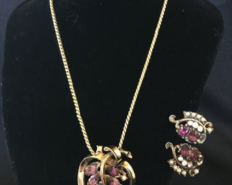 Purple Stones Set in a Gold Tone Round Pendant & Clip Earrings