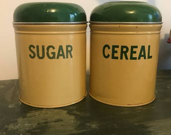 Two vintage cream and green tins