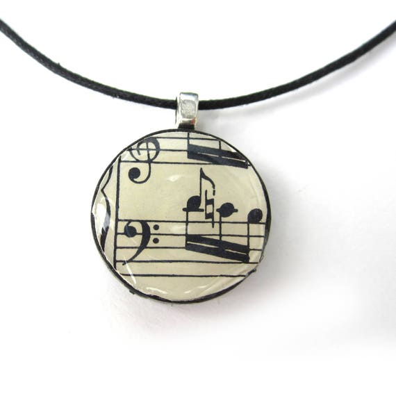 Music necklace, made of scrabble/checkers stone
