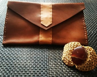 Beige and brown leather clutch
