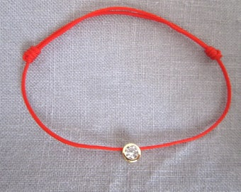 BRACELET RED THREAD AND GOLD PLATED ZIRCONIUM