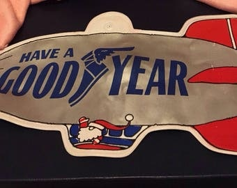 """Santa will be arriving this year in the GOODYEAR BLIMP !!!!! Inflatable, measures approximately 10 1/2"""" x 6""""."""