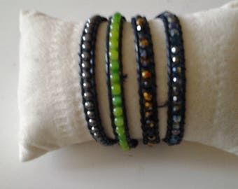 Wrap bracelet has 4 rows on leather with genuine stones