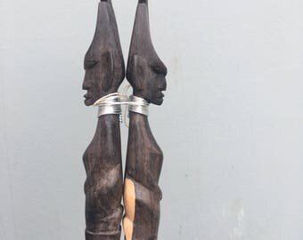 Mid century carved wooden Kenyan fork and spoon salad servers