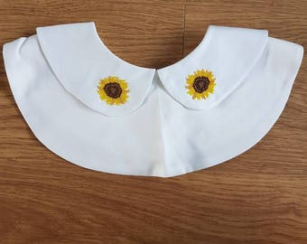 White detachable collar with sunflowers cross stitched.