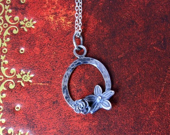 Handmade silver pendant with flower