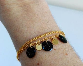 Gold Bracelet chains fancy and glittery black tassels