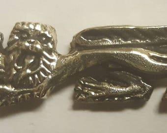 Heraldic lion solid brass badge