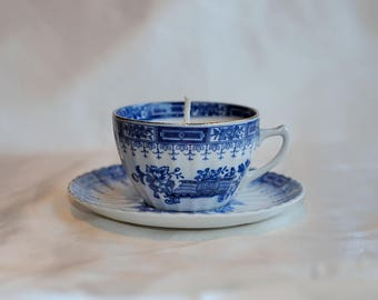 Chinese cup and saucer with soy candle