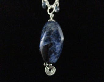 Necklace with large marbled blue pendant