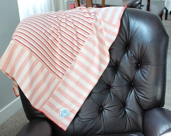 Pink striped jersey knit blanket with pink hem