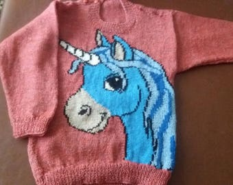 Hand knitted childs jumper with unicorn motif. Fit age 3 - 5
