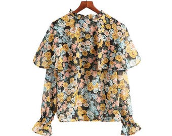 FLORAL CAPE BLOUSE