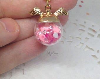 Globe cherry blossom pendant necklace