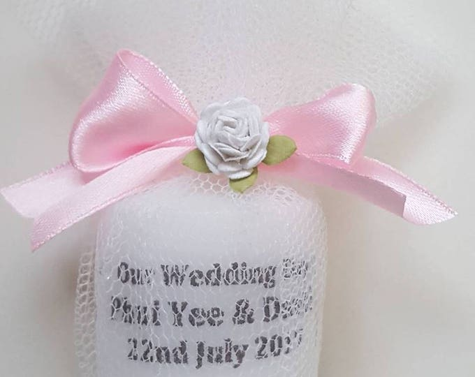 Wedding personalised candle favour wrapped in tulle.