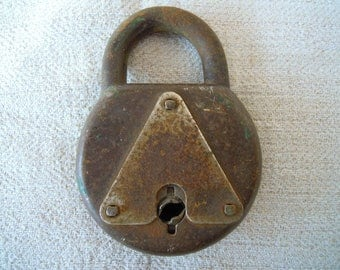 Antique padlock. Old padlock. Thin padlock. Rustic padlock. Not works. Vintage padlock. Unusual design. Rare padlock. Lock. Antique lock.