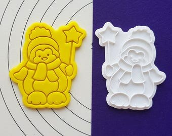 Penguin holding Star Cookie Cutter and Stamp