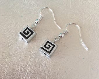 Silver earrings with black design.  Silver ear wires.