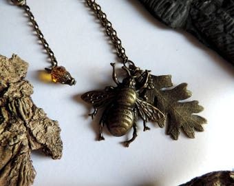 Necklace bronze; Bee, leaf of oak, Brown faceted glass beads, bronze Cap.