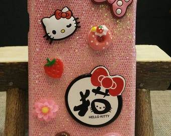 Handmade glittered iPhone 6 plus case with cutie hello kitty charms