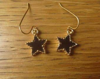 gold stars and black earrings
