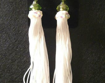 White tassel earrings with green beading and Crystal AB rhinestones