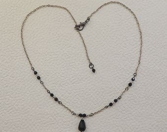 Black stones and metal necklace