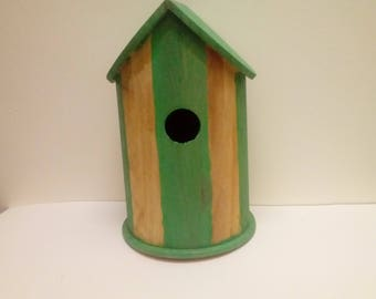 Green and beige birdhouse