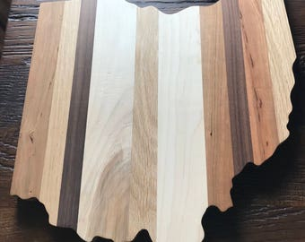 Amish hand made solid wood Ohio state shaped cutting board. Buckeyes